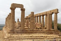 Temple of Juno Agrigento. Temple Valley, Agrigento, Sicily, Italy. The ruins of Temple of Juno on top of a hill. Several doric columns and the stairs to climb it royalty free stock image