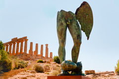 Temple of Juno in Valley of the Temples, Sicily. View Dorian columns of Temple of Juno and bronze statue in Valley of the Temples in Agrigento, Sicily royalty free stock photos