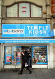 Temple Kiosk Newsagents and Mobile Services. London, England - April 02, 2015: A man walking past a newsagent and tobacconist advertising Lebara Mobile stock photography