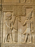 Temple of Kom Ombo, Egypt: the Pharaoh and god Horus Stock Photos