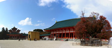 A Temple in Kyoto, Japan. Heian Shrine in Kyoto with bright red beams and dark green roof tiles Royalty Free Stock Photography