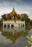 Temple on the Lake. Thai Temple with marble steps sits in a lake in Thailand Stock Photos