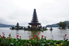 Temple on the lake in Bali Indonesia with flowers. Beautiful royalty free stock photography