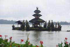 Temple on the lake in Bali Indonesia with flowers. Beautiful stock photography