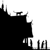 Temple leopard. Editable vector silhouette of a leopard on a temple roof with figures as separate objects Stock Image