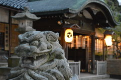 Temple Lion. Stone lion protecting the temple grounds Stock Photo