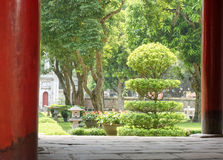 Temple of Literature in Hanoi. With landscaped gardens and bonsai tree in foreground, Vietnam Stock Image