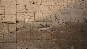Temple of Medinet Habu. Egypt, Luxor. The Mortuary Temple of Ramesses III at Medinet Habu is an important New Kingdom period. Structure in the West Bank of stock images