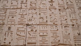 Temple of Medinet Habu. Egypt, Luxor. The Mortuary Temple of Ramesses III at Medinet Habu is an important New Kingdom period. Structure in the West Bank of royalty free stock image