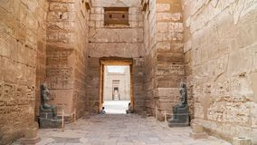 Temple of Medinet Habu. Egypt, Luxor. The Mortuary Temple of Ramesses III at Medinet Habu is an important New Kingdom period. Structure in the West Bank of stock photo