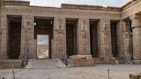 Temple of Medinet Habu. Egypt, Luxor. The Mortuary Temple of Ramesses III at Medinet Habu is an important New Kingdom period. Structure in the West Bank of stock image