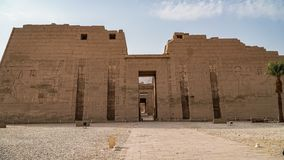 Temple of Medinet Habu. Egypt, Luxor. The Mortuary Temple of Ramesses III at Medinet Habu is an important New Kingdom period. Structure in the West Bank of royalty free stock images