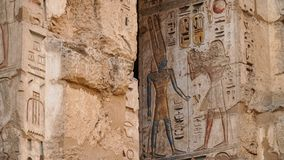 Temple of Medinet Habu. Egypt, Luxor. The Mortuary Temple of Ramesses III at Medinet Habu is an important New Kingdom period. Structure in the West Bank of stock photos