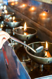 In the temple of merit increased life. With the oil lamp Stock Photography