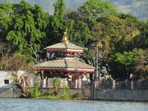 Temple in the middle of a lake stock image