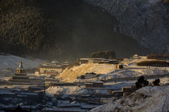 Temple in the morning. Langmusi, Gannan Tibetan Autonomous Prefecture Luqu County is under the jurisdiction of a small town. A small stream flowing from the town Stock Image
