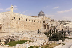 Temple Mount and Al-Aqsa Mosque. The walls of the Temple Mount in the Old City of Jerusalem in Isreal. Over the tall walls, the dome of the Al-Aqsa mosque and a Royalty Free Stock Images