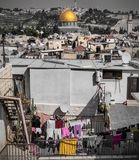 The temple mount with the golden dome in the old city of Jerusalem. View of the old city of Jerusalem Israel seen from the roofs is the temple mount as the Stock Image