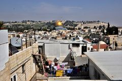 The temple mount with the golden dome in the old city of Jerusalem. View of the old city of Jerusalem Israel seen from the roofs is the temple mount as the Royalty Free Stock Photo