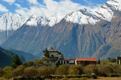 A temple near Larjung village on the Annapurna Circuit, Nepal. With the Dhaulagiri Range in the background.  stock images