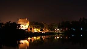 The temple is near riverside at Ayuttaya in thailand. At night , the thai church near river choapaya is in Ayuttaya at Thailand Royalty Free Stock Images