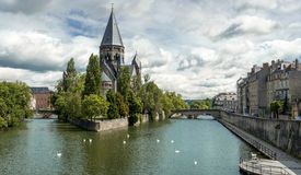 Temple Neuf in Metz. The cloudy sky makes more dramatic this composite ultra high-res picture upon the riverside of Metz, with the sight of Mosel and the royalty free stock photography