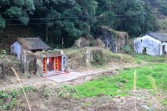 Temple next to an abandoned houses in an traditional village in HK. An traditional temple remains alive standing next to an abandoned house in an old Hakka Royalty Free Stock Photos