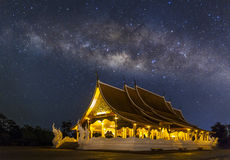 Temple at night with milky way. Wat Pruprow in Sirinthorn Ubonratchatani Stock Photo