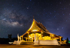 Temple at night with milky way. Wat Pruprow in Sirinthorn Ubonratchatani Royalty Free Stock Images
