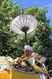 Temple Offerings and Umbrella, Bali Stock Photography