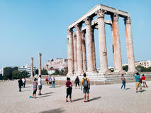Temple of Olympian Zeus and Acropolis Hill, Athens, Greece. Athens, Greece - October 16, 2016: Tourists near Temple of Olympian Zeus and Acropolis Hill, Athens Royalty Free Stock Image