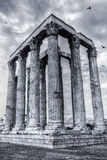 Temple of Olympian Zeus. The Temple of Olympian Zeus, also known as the Olympieion or Columns of the Olympian Zeus, is a colossal ruined temple in the center of Royalty Free Stock Photos