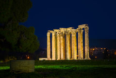 The Temple of Olympian Zeus in Athens, Greece. The Temple of Olympian Zeus is a colossal ruined temple dedicated to the Olympian gods Stock Photo