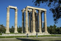 Temple of Olympian Zeus in Athens, Greece. Athens, Greece - December 27: Tourists visiting Temple of Olympian Zeus on December 27, 2017 in Athens, Greece Royalty Free Stock Photo