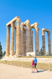Temple of Olympian Zeus in Athens, Greece. Athens, Greece - June 13, 2017: Tourists visit the Temple of Olympian Zeus, a major historic landmark in Athens Royalty Free Stock Photography