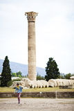 Temple of Olympian Zeus, Ruins of the ancient Temple of Olympian Zeus in the center of Athens, Greece. A tourist walks on ancient Stock Photos