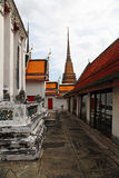 Temple with orange and red roof. Part of Beautiful Wat Phra Kaeo temple with orange and red roof in Thailand Stock Image