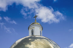 Temple of Orthodox Christians with a gold cupola 10. Temple of Orthodox Christians with a gold cupola against a blue sky with white clouds Royalty Free Stock Photo