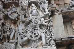 Hoysaleswara Temple outside wall carved with sculpture of Garuda, the humanoid bird Royalty Free Stock Image