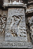 Hoysaleswara Temple outside wall carved with sculpture of Lord krishna lifting govardhana giri Royalty Free Stock Photo