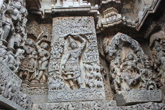 Hoysaleswara Temple outside wall carved with sculpture of Lord krishna lifting govardhana giri Royalty Free Stock Image