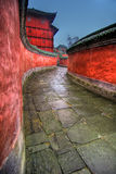 Temple Passage. A winding passage flanked by red walls leading to the Wudang Shan Temple in China Royalty Free Stock Photography
