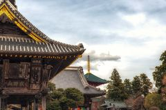 Temple of Peace pagoda, Naritasan shinshoji buddhist temple, Narita, Japan. Narita, Japan 17 March, 2018: Temple of Peace pagoda, Gakudo and Komyodo hall roof royalty free stock photo