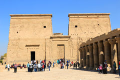 Temple of Philae dedicated to the Goddess Isis. ASWAN, EGYPT - FEBRUARY 1, 2016: Tourists visiting the Graeco-Roman Temple of Philae dedicated to the cult of royalty free stock photo