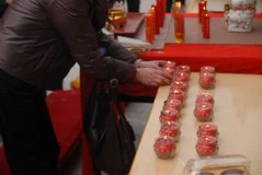 A platoon candlestick. In the temple, the platoon Candlestick, the tribute before the statue royalty free stock photos