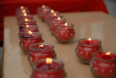A platoon candlestick. In the temple, the platoon Candlestick, the tribute before the statue royalty free stock photography