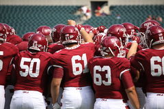 Temple players huddle before a game royalty free stock image