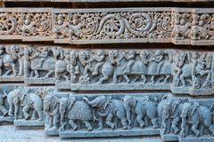 Temple plinth carvings in Karnataka, India. Detail from intricate exterior carvings on the lower part of the outer wall of the 13th century Channakeshava, or stock photography