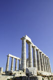 Temple Of Poseidon. Greek ruins located on Cape Sounion, Athens, Greece Stock Photo