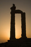Temple of Poseidon, Cape Sounion, Greece. Pillars of the Temple of Poseidon at Cape Sounion in Greece at sunset stock photos